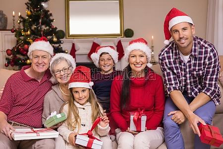 multigeneration family wearing santa hats on