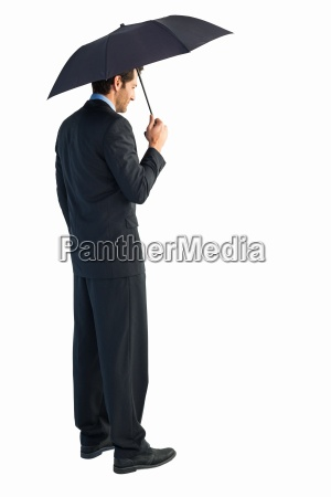 rear view of classy businessman holding