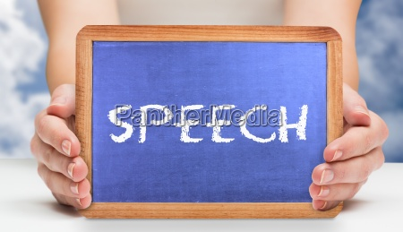 speech against bright blue sky with