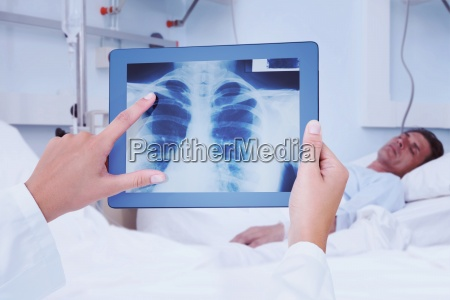 composite image of doctor looking at