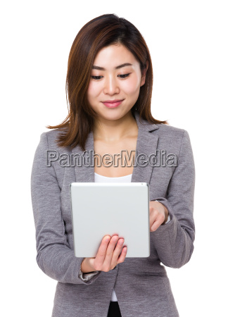 asian young businesswoman use of the
