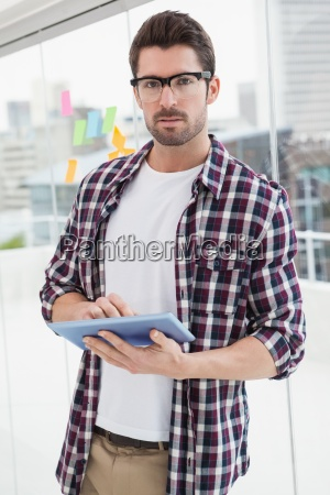 concentrated businessman using digital tablet