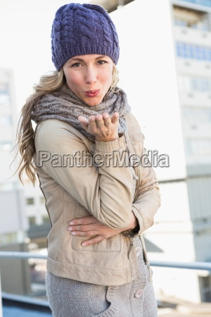pretty blonde in warm clothes blowing