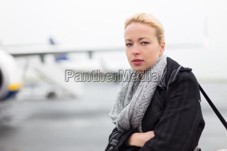 woman boarding airplain