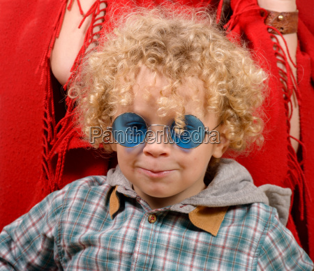 portrait of a little blond curly