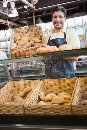 portrait of smiling worker showing basket