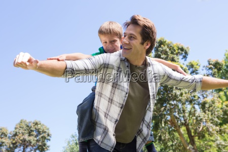 father and son having fun in