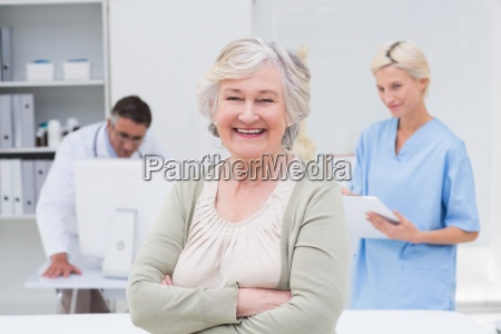 patient smiling while doctor and nurse