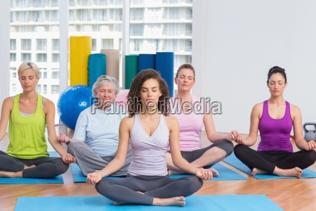class with instructor in lotus position