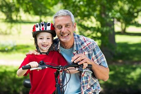 happy little boy on his bike