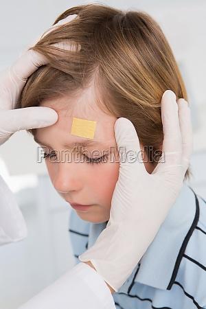 doctor making plaster in little boy