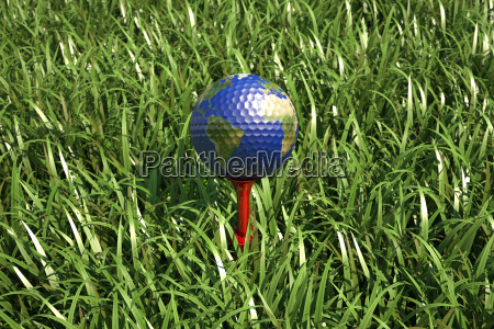 golf ball on tee in the