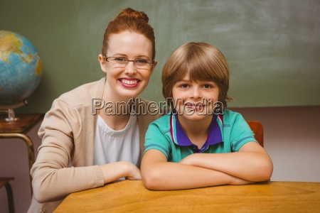 happy female teacher and little boy