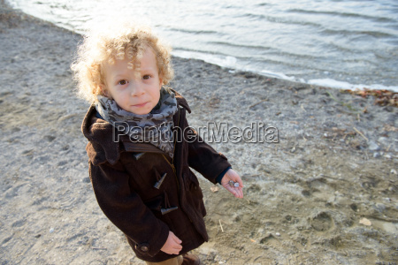 little blond boy playing on the