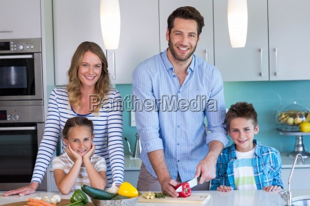 happy family preparing vegetables together