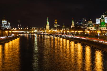 illuminated moskva river and kremlin in