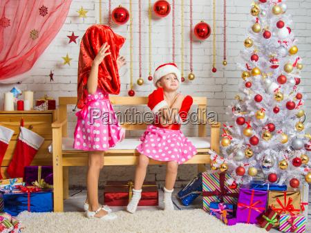 girl wearing santa claus bag on