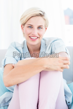 pretty blonde woman sitting on the