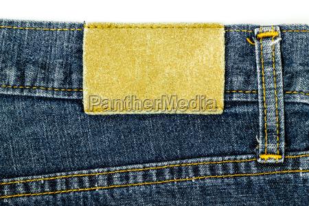 lederjeansetikett auf jeans genaeht