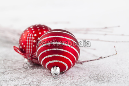 red christmas balls on sparkling silver