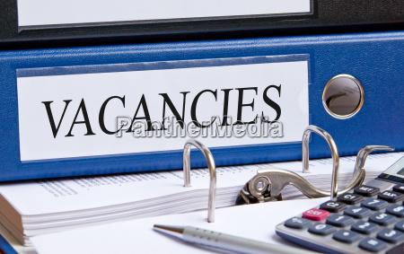 vacancies blue binder in the
