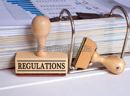 regulations rubber stamp in the