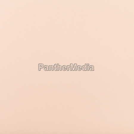 peachy colored square sheet of paper