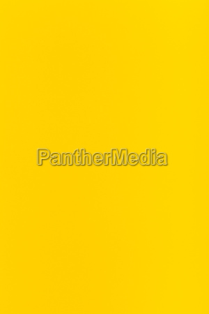 yellow colored vertical sheet of paper