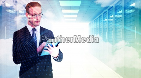 composite image of unsmiling businessman using