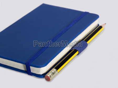blue notebook and pencil