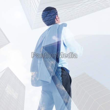 composite image of businessman holding his