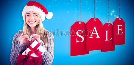composite image of festive blonde holding