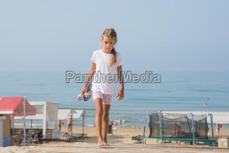 six year old girl walking on