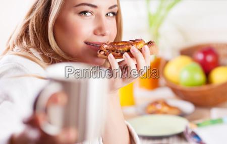 happy girl having breakfast