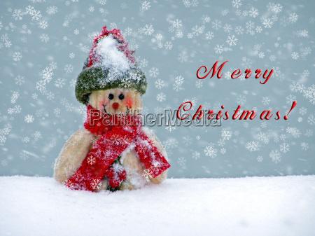 frohe weihnachtspostkarte mit einem schneemann im