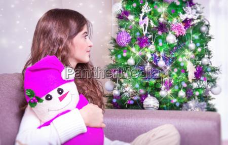 happy girl near christmas tree