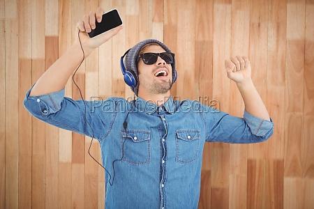 hipster wearing sunglasses enjoying music