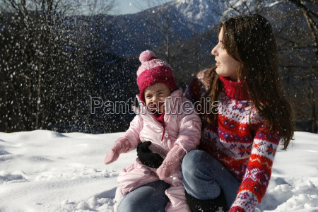 mother and daughter playing in the