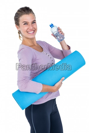 woman holding water bottle and exercise