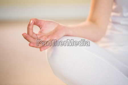 mid section of woman in yoga