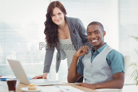 portrait of smiling business professionals working