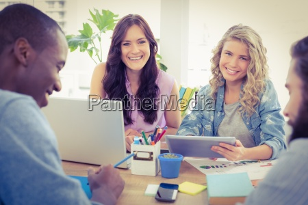 portrait of smiling female business people