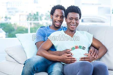 portrait of happy couple sitting on