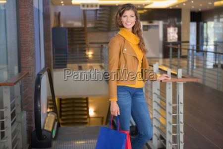 portrait of smiling woman with shopping