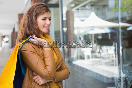 smiling woman holding shopping bags and