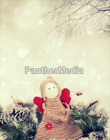 angel figurine on holiday background
