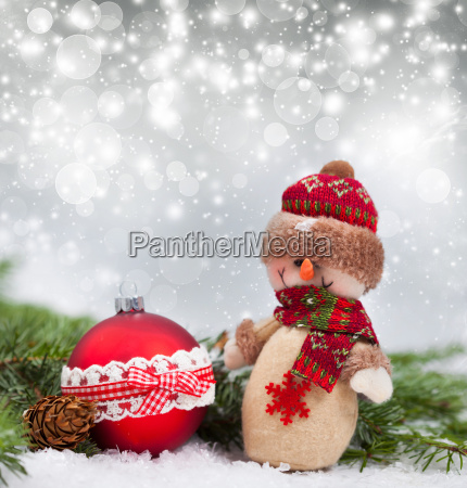 holiday background with christmas ball and