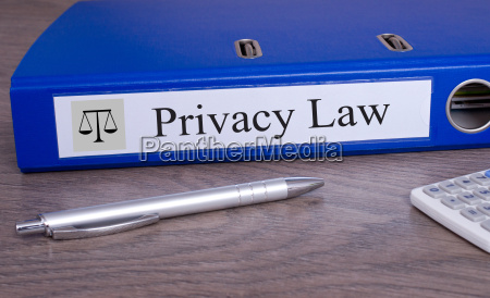 privacy law blue binder in the