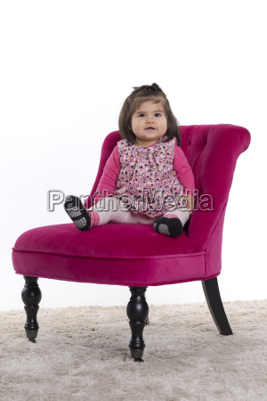 toddler sitting proudly on a chair
