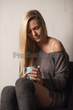 young blonde woman with coffee cup
